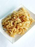 Amorce blanche cuite à la friteuse avec du sel épicé Photographie stock