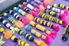 Amorce colorée de caoutchouc mousse dans la boutique de pêche Image stock