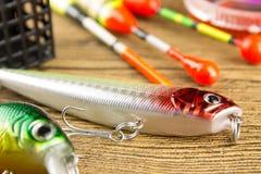 Amorce de rotation pour pêcher sur le fond en bois Image stock