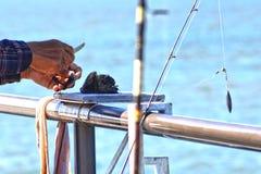 Amorce du crochet pour la pêche de pilier Photos stock