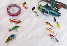 Amorces et articles de pêche artificiels comme cadre pour l'inscription, texte Image stock