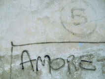 Amore on concrete wall Royalty Free Stock Photos