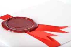 Amore-lettera con la guarnizione rossa Fotografia Stock