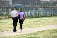 Amore sotto la pioggia Fotografia Stock Libera da Diritti