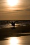 Amore in una spiaggia Fotografia Stock