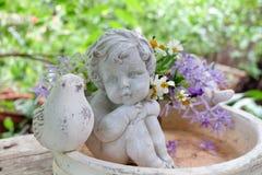 Amorek i kwiaty Obraz Royalty Free