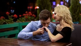 Free Amorous Admirer Kissing Hand Of His Beautiful Lady, Sitting In Cozy Restaurant Royalty Free Stock Photo - 145144235