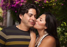 Amorous Attractive Hispanic Couple At The Park. Happy Attractive Hispanic Couple Enjoying Themselves At The Park Royalty Free Stock Photos
