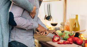 Free Amorous Black Couple Cooking Together In Kitchen Royalty Free Stock Image - 136706696