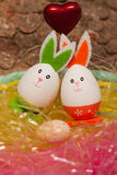 Amorous couple with a baby Easter egg in Easter Royalty Free Stock Image