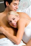 Amorous couple in bedroom Stock Photo