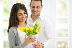 Amorous couple with bouquet of tulips Stock Photo