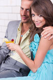 Amorous couple celebrating together Royalty Free Stock Images