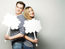 Amorous couple holding blank paper on stick. Stock Photography