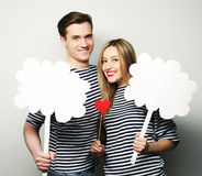 Amorous couple holding blank paper on stick. Royalty Free Stock Photo
