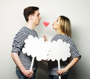 Amorous couple holding blank paper on stick. Royalty Free Stock Images