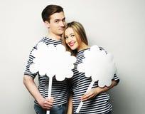 Amorous couple holding blank paper on stick. Royalty Free Stock Image