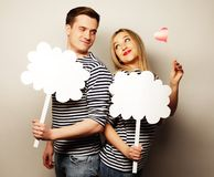 Amorous couple holding blank paper on stick. Stock Photo