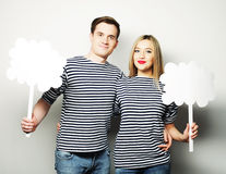 Amorous couple holding blank paper on stick. Royalty Free Stock Photos