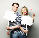 Amorous couple holding blank paper on stick. Stock Images