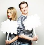 Amorous couple holding blank paper on stick. Stock Image