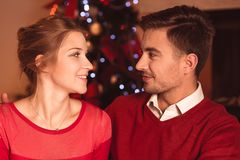 Amorous couple in red clothes Stock Image