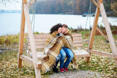 Amorous couple on romantic date on swings outdoor Royalty Free Stock Photography