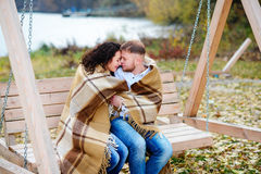 Amorous couple on romantic date on swings outdoor Stock Images