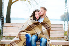 Amorous couple on romantic date on swings outdoor Royalty Free Stock Photo