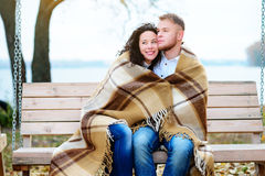 Amorous couple on romantic date on swings outdoor stock photo