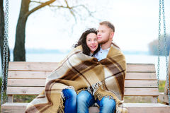 Amorous couple on romantic date on swings outdoor Stock Photography