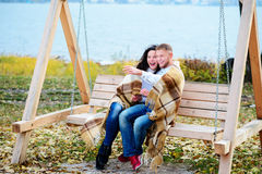 Amorous couple on romantic date on swings outdoor Stock Photos