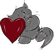 amorous kitten with heart Stock Image