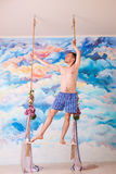 Amorous man in underpants stay on wooden swing Royalty Free Stock Photo