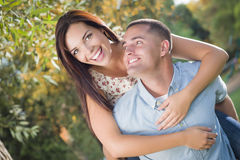 Amorous Mixed Race Couple Portrait in the Park Royalty Free Stock Photography