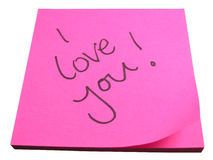 Amorous note. Macro close up of pink post it note with the words I love you written on it, isolated on white background Stock Photos