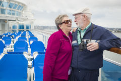 Amorous Senior Couple Flirting on Deck of a Cruise Ship Royalty Free Stock Images