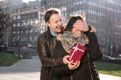Man wants to surprise the girl with a gift Stock Photos