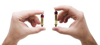 Amortiguadores de choque en manos Imagen de archivo libre de regalías