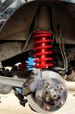 Amortiguadores de choque y suspensión de la primavera del coche del camino Imagen de archivo