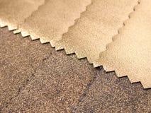 Amostra dourada da textura de matéria têxtil Fotografia de Stock