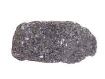 Amostra natural de mineral da cromita, o minério o mais importante do cromo no fundo branco fotos de stock