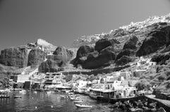 Amoudi bay oia santorini greek island. Amoudi bay the fishing harbor port built into the caldera on the greek cyclades island of santorini town of oia ia on the stock photos