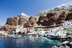 Amoudi port oia santorini greek island. Amoudi bay the fishing harbor port built into the caldera on the greek cyclades island of santorini town of oia ia on the royalty free stock image