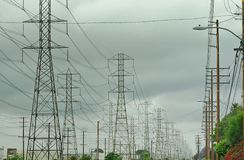 Electrical grid towers receding into infinity royalty free stock images