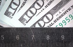 Amount of money measured a ruler Royalty Free Stock Image