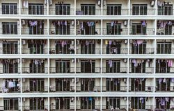 Amount of similar balconies with drying clothes. Amount of similar balconies and windows with drying clothes on them stock images