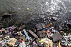 Amount of trash polluting river water stock photography
