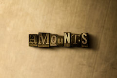 AMOUNTS - close-up of grungy vintage typeset word on metal backdrop Royalty Free Stock Images