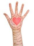 Amour à main levée et rouge de lettres entendus en main Photographie stock